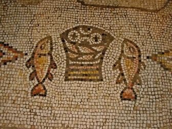 Mosaic of two fish flanking a basket of loaves